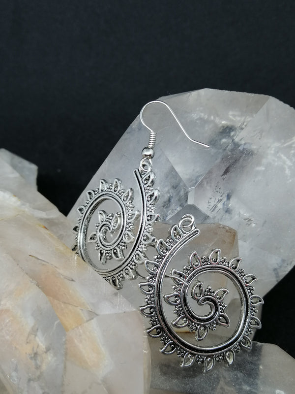 Metallic Earrings on top of a crystal