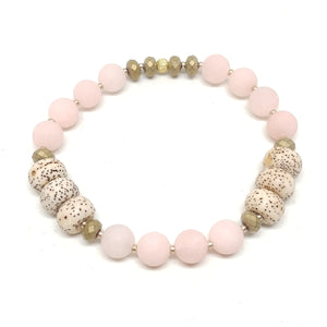 Wildflower stretch bracelet, pale peach jade (dyed), bodhi seeds, hematite, gold spacer beads.