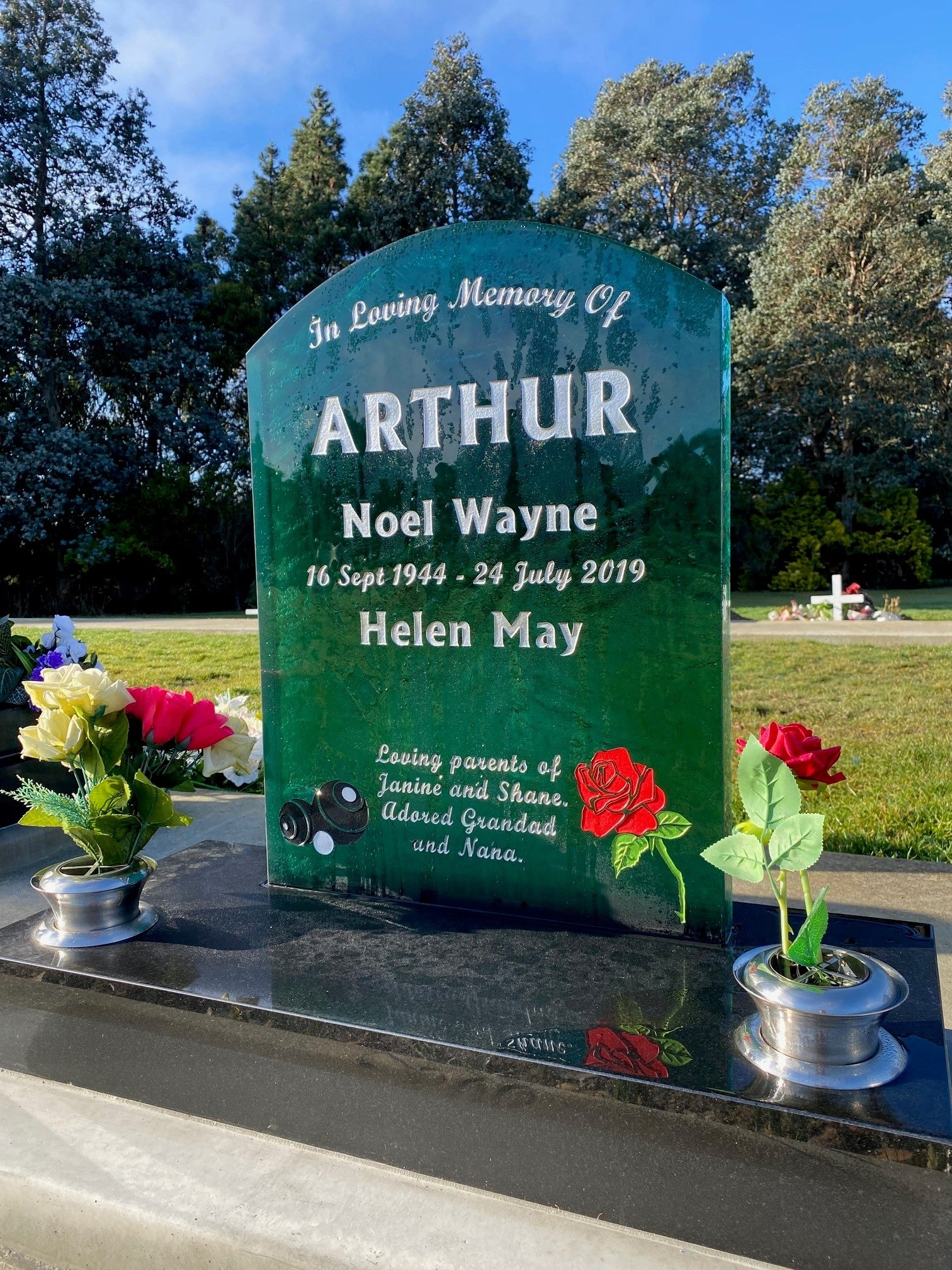 Green Glass headstone with coloured red rose and inscription memorial