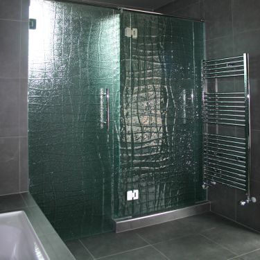 inline hinged shower in slumped handmade glass - made in new zealand - custom patterned textured safety toughened glass