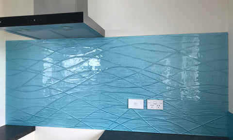 Denim blue glass custom made splash back with conformity lines.
