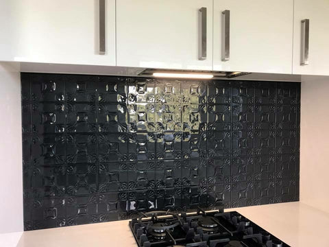 Black pressed patter slumped glass splashback from escape glass