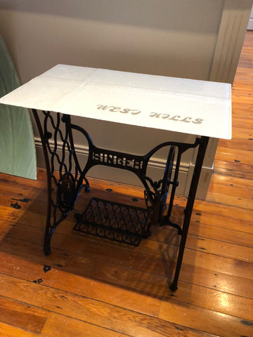 Glass white slumped singer sewing station turned into a table