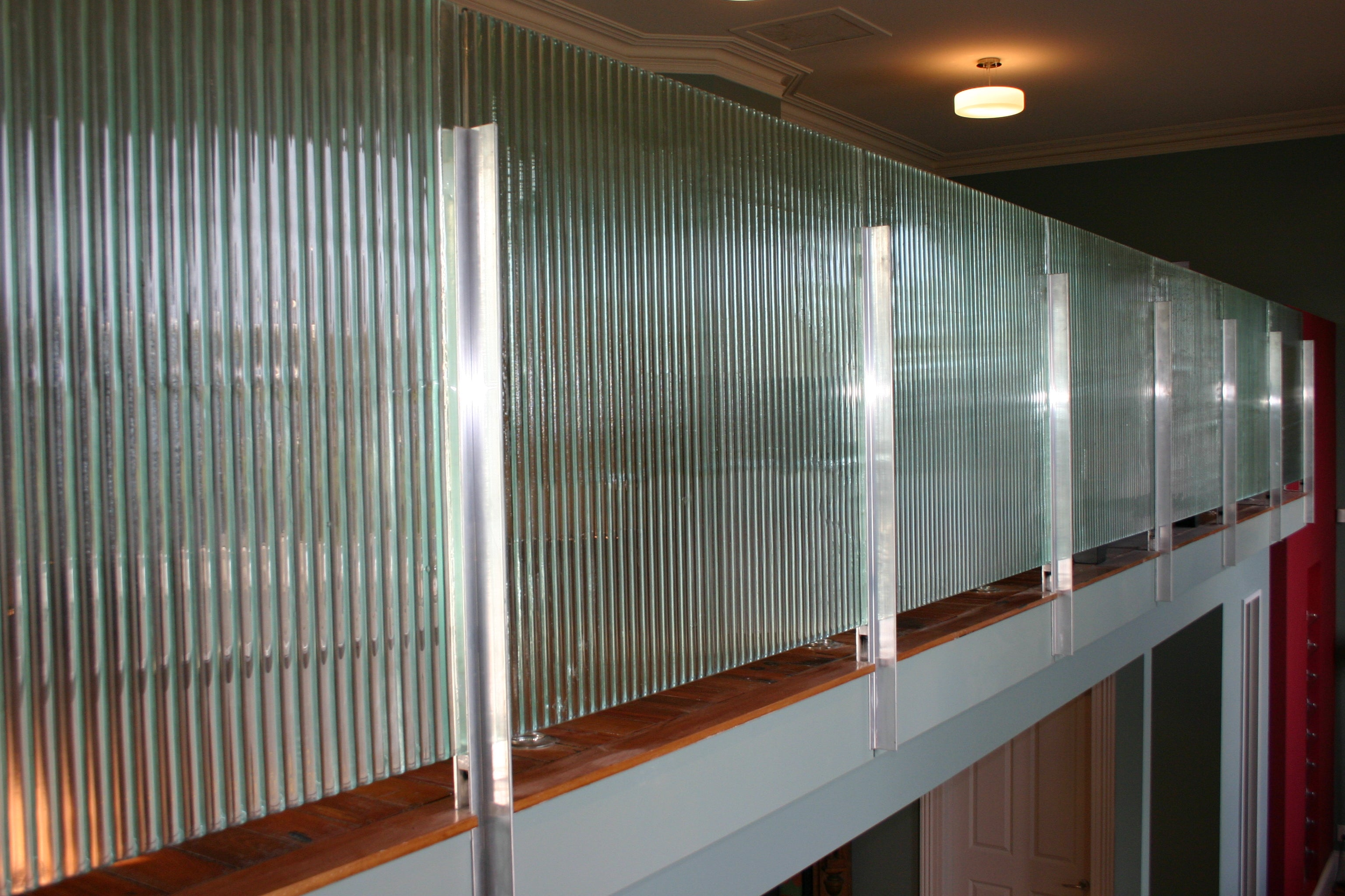 broad reeded fluted patterned slumped textured handmade glass in corrugate balustrading