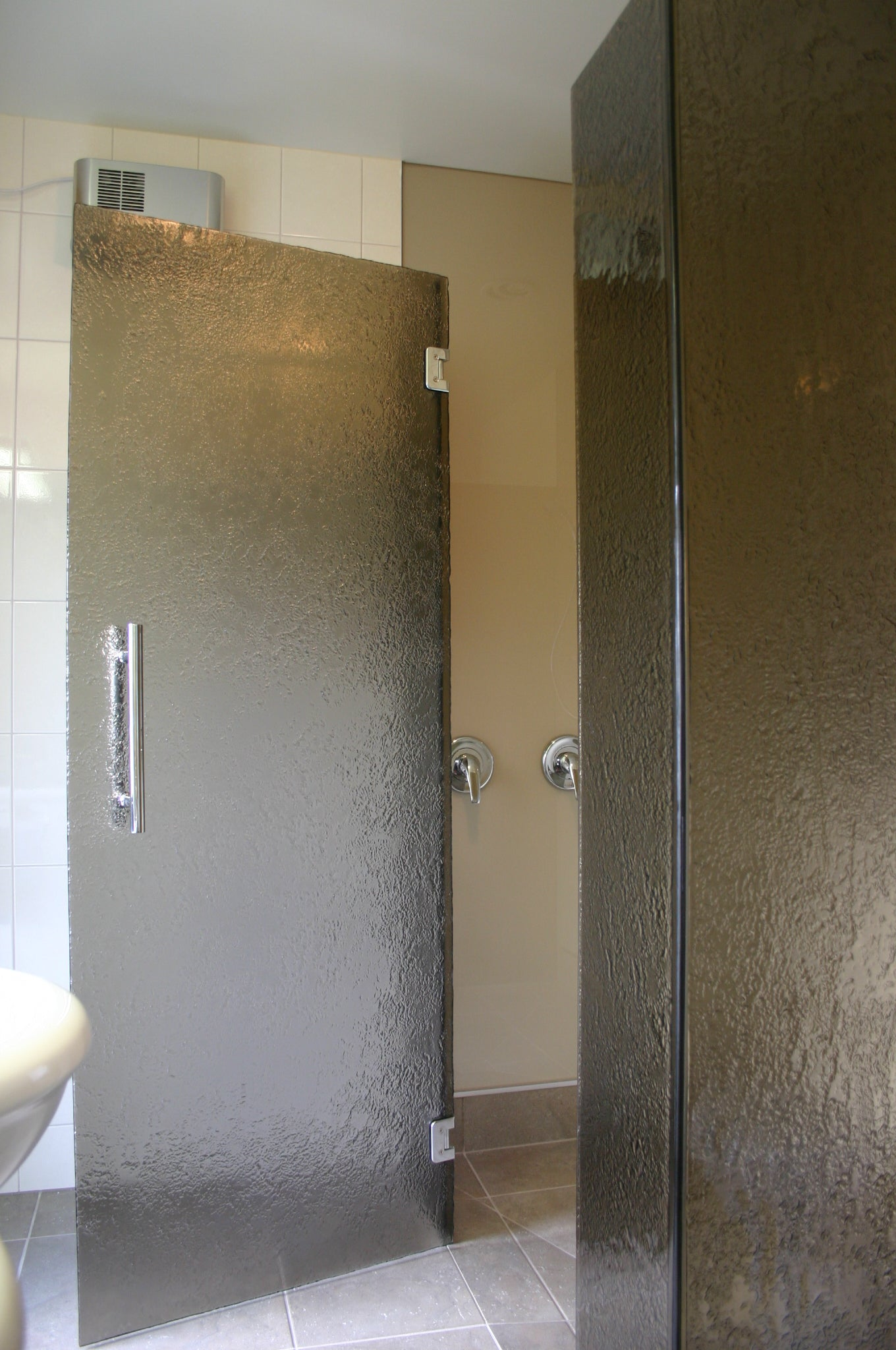 Sliding Shower Sliding Showers are the modern alternative to hinged doors. They are ideal for an area where there is not enough room for a door to swing into the bathroom, Our suspended sliding doors systems use stainless steel components for an engineered smooth movement.  Sliding Showers are available in Square/Corner Showers as well as inline showers     At Viridian Glass we custom make all of our showers to work with the space you have in your bathroom  All toughened safety glass and installations meet Building Code and NZS 4223.3 Human Impact Safety Requirements.     Why Choose a Sliding Shower? Sliding showers are both stylish and functional. Frameless glass Sliding shower enclosures look incredible and are ideal for bathrooms of all sizes. A sliding glass shower door is a clean and modern design, saving on bathroom space when compared with the footprint of a swing panel door. Sliding Showers Recommendations Viridian Glass recommends a minimum width of 1200mm for a sliding shower.