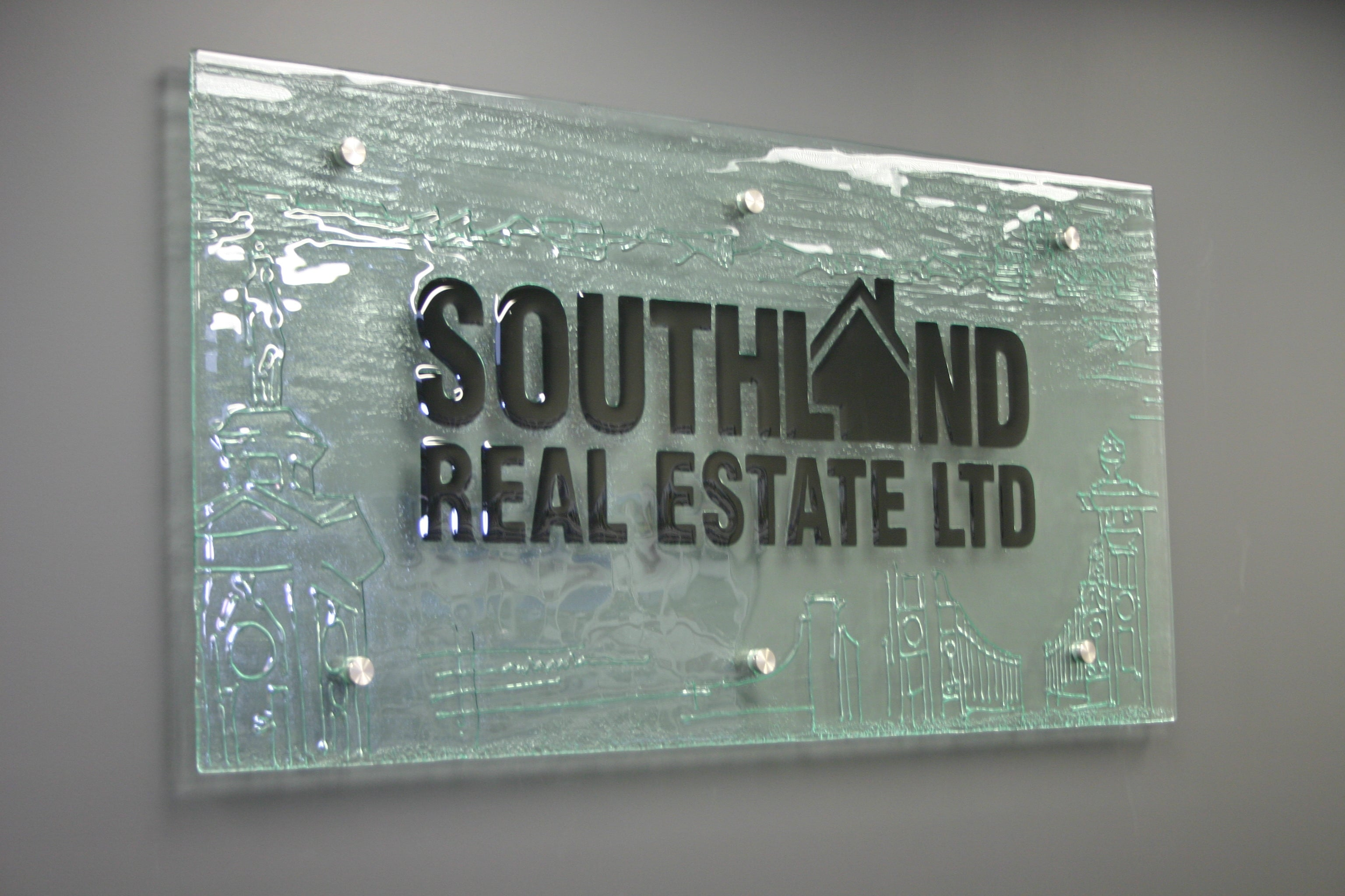 Southland Real estate business glass signage sign