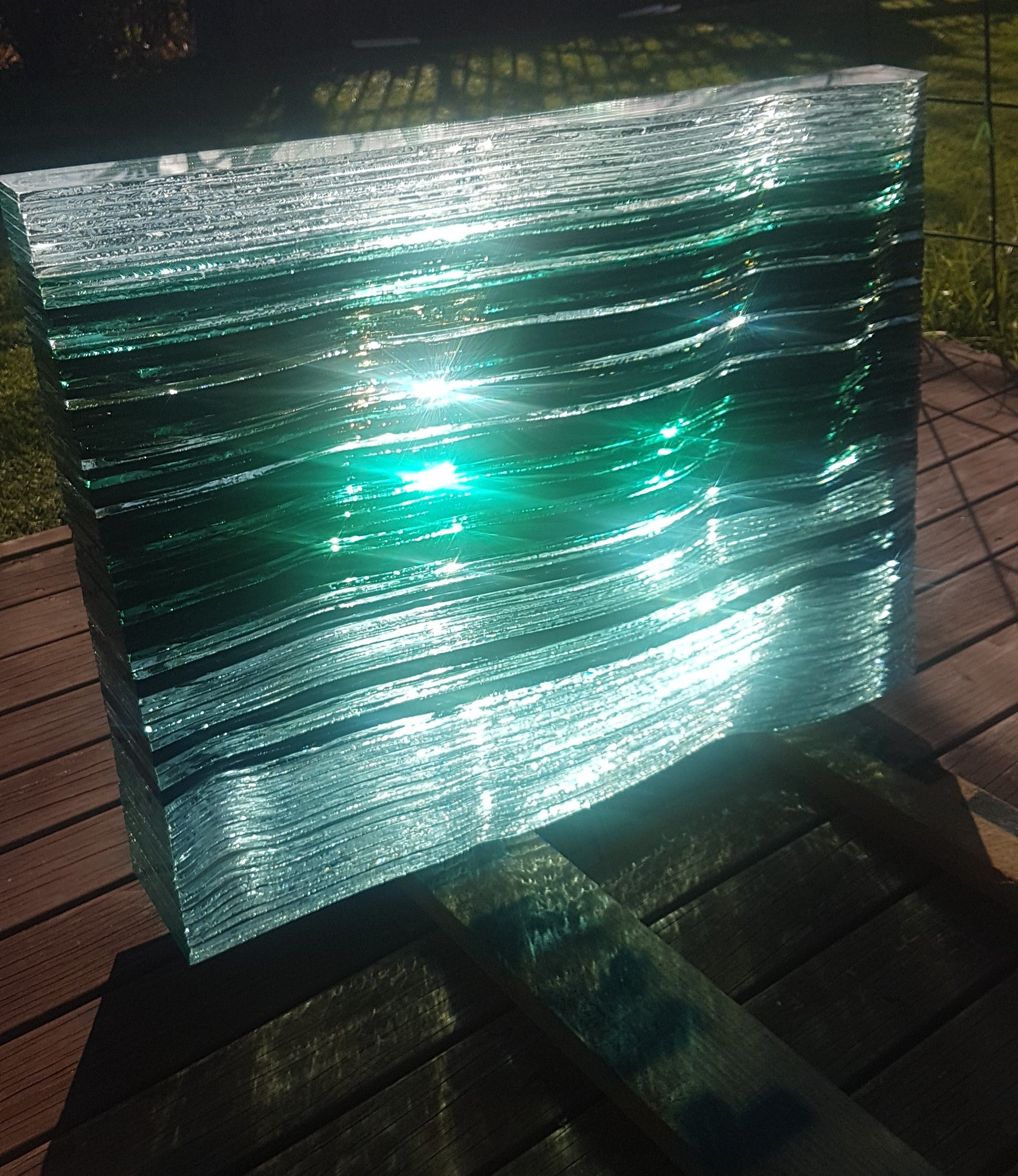 Stacked glass wave headstone