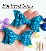 Solid colors faux leather pig tails bows, set of 2. Sparkling blue