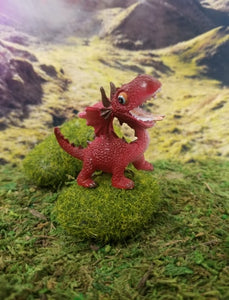 Laughing mini red dragon
