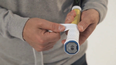 Applying new grip to a racket