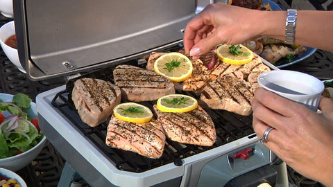 Cuisinart CEG-980 Outdoor Electric Grill  with meat and lemon