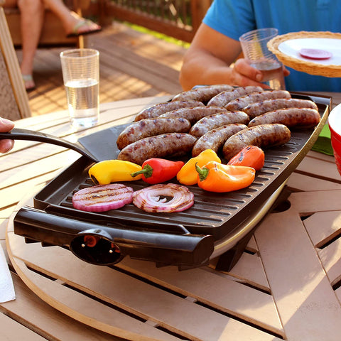 George Foreman Indoor-Outdoor Electric Grill served on table