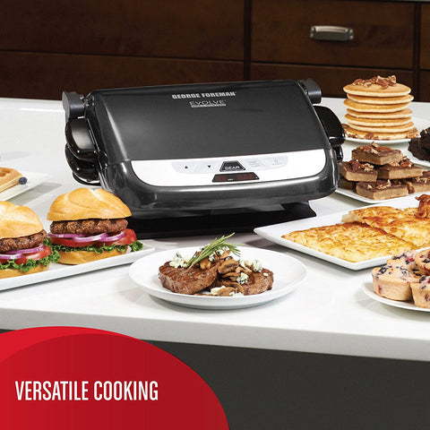 Grill surrounded by cooked food on table
