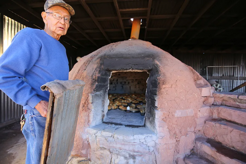 These traditional horno ovens can still be seen in some backyards.