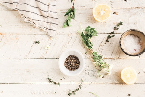 lemon and herbs on a table