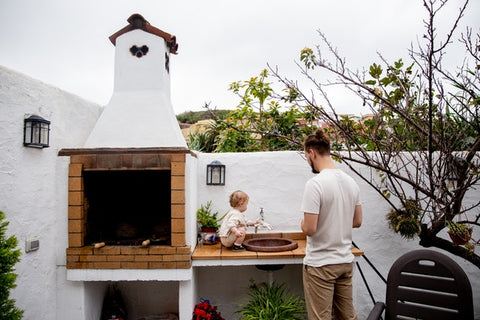 man and child on an outdoor sink