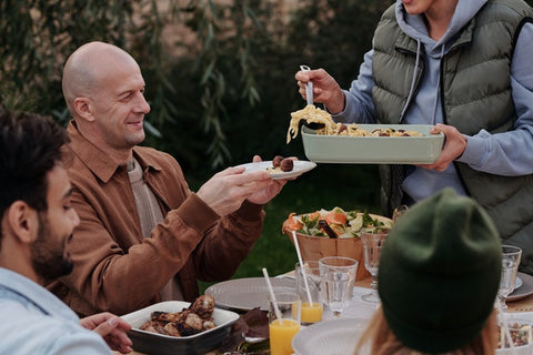 man being served food by company