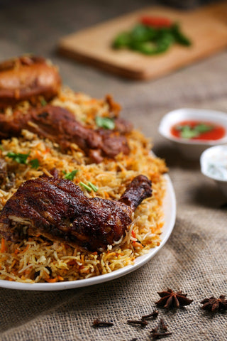 plate of rice and cooked chicken