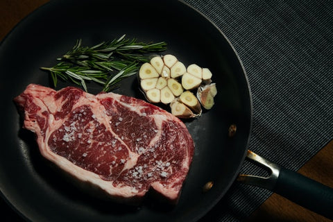 raw meat with rosemary and garlic