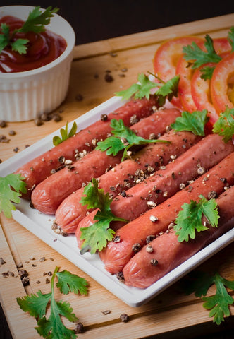 sausages on white ceramic plate
