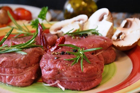 steak with garnish and mushroom