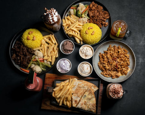 top view of assorted food on black plates