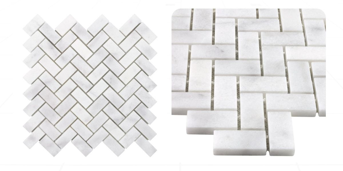 Gray and white marble mosaic tile in a herringbone pattern