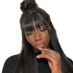 A person with bangs on the head of a lace wig
