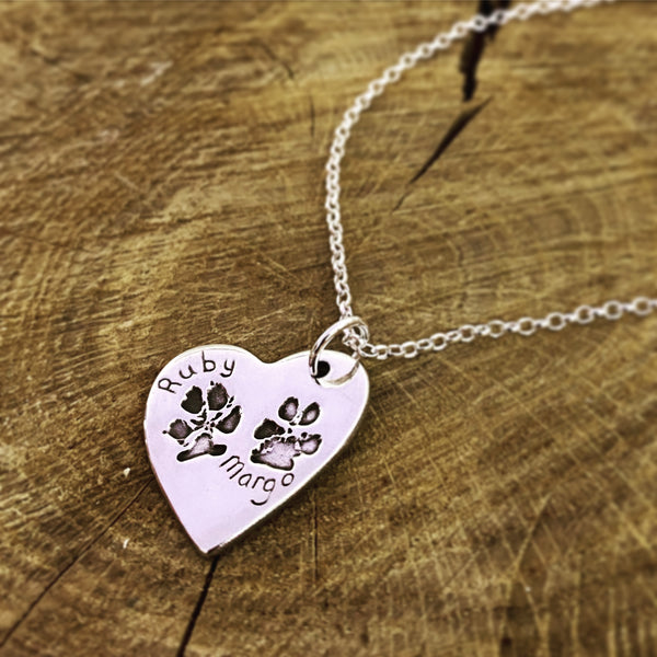 double paw print heart pendant on a belcher chain