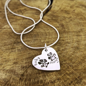 double paw print heart pendant on a snake chain