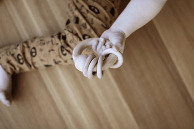 wooden  rattle with four little rattle rings baby
