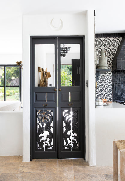 black swing doors with detailed cut outs
