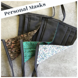 assorted patterns and gray personal face masks with gray ties