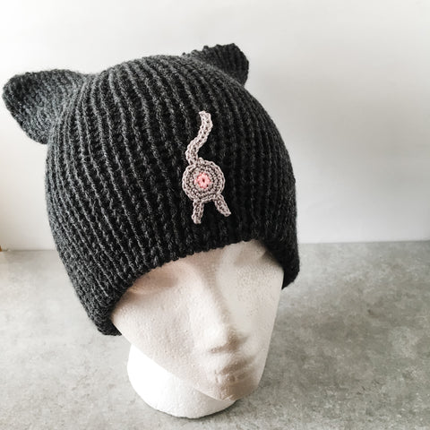 black cat ear cat butt beanie with a gray cat butt