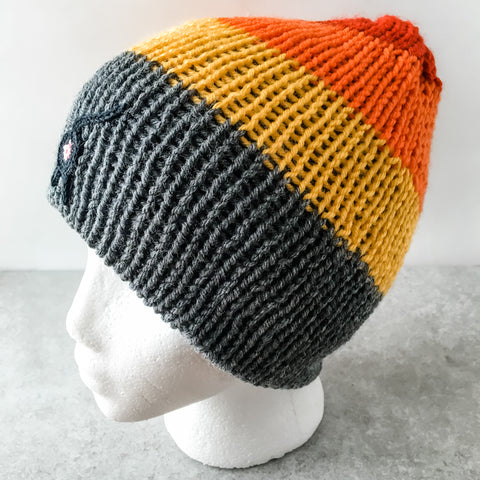 gray, red, orange, and yellow cat butt beanie with a black cat butt