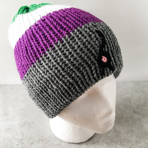 gray, green, pale blue, and purple cat butt beanie with a black cat butt
