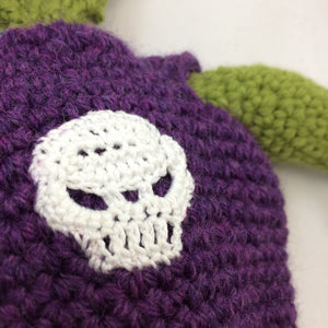 Closeup of a crocheted skull applique