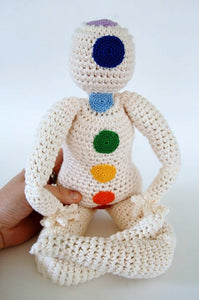 Crocheted doll with rainbow Chakra points