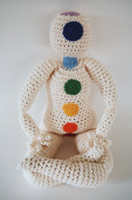 Crocheted doll with rainbow Chakra points in Lotus pose