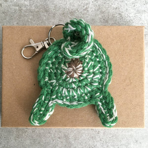 Lucky pug butt keychain on a gift box