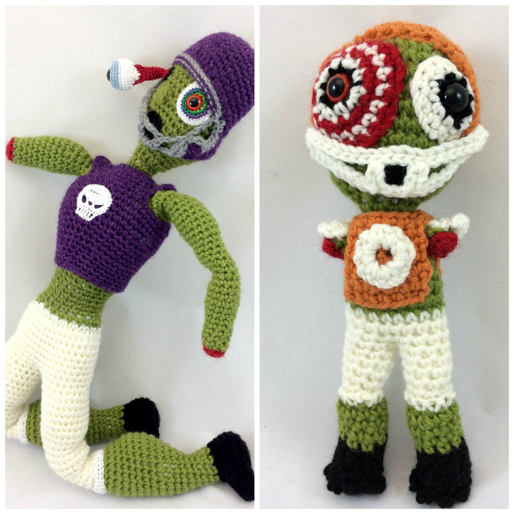 Large crocheted zombie football player doll next to the small amigurumi zombie football player doll