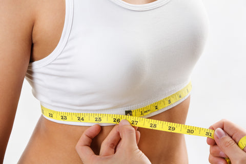Measure your bra size by measuring below your breasts and around your back