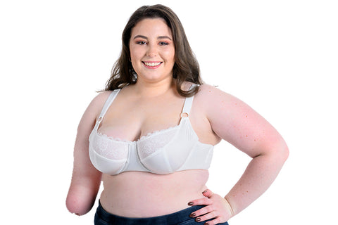 Girl in white bra with a limb difference