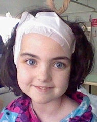 Young girl with her head bandaged