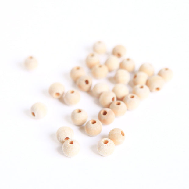 Lot de 30 perles en bois - Naturel - 7mm