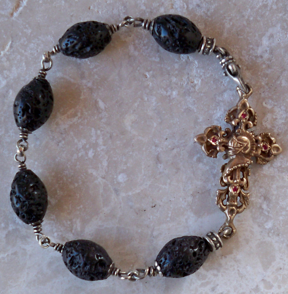 Bronze cross with rubies and black lava beads