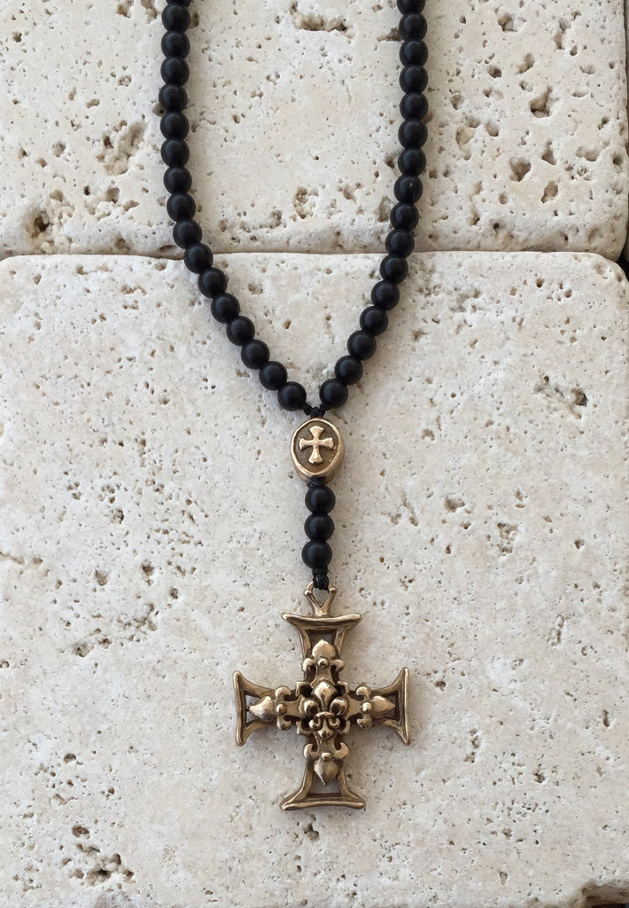 Bronze cross with fleur de lis center and onyx beads