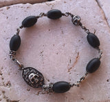 Sterling Silver Two Skull Bracelet with Oval Onyx Beads