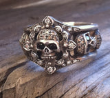 Sterling Silver Five Skull Diamond Pave with Internal Ruby Ring