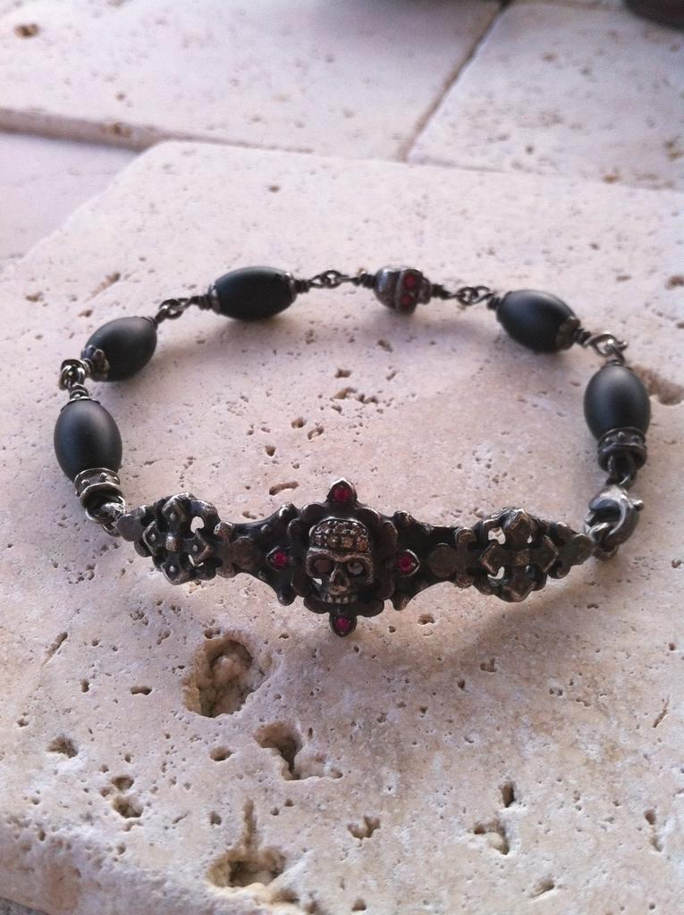 Sterling Silver Dark Antiqued Two Skull Bar Diamond & Ruby Pave Bracelet with Oval Onyx Beads